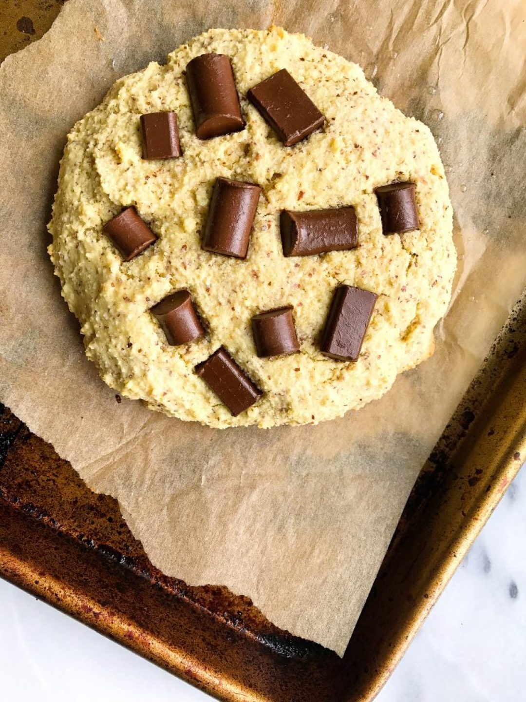 One Giant Paleo Chocolate Chip Protein Cookie that is paleo, grain and dairy-free!