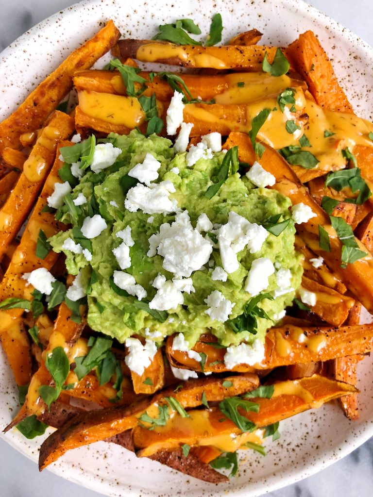 Loaded Guacamole Baked Sweet Potato Fries for a delicious and flavorful french fry recipe that is gluten-free and dairy-free!