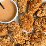 Healthier Paleo Crispy Chicken Tenders made with 3 key ingredients and paired with a homemade special sauce to dip!