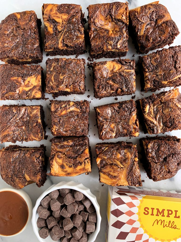 Sharing these Healthy Gluten-free Cheesecake Brownies made with a grain-free brownie base  and topped with a delicious and simple cheesecake layer.