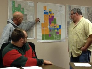Sturtevant Village President Steve Jansen (l) explains to trustees where Mount Pleasant is asking for sewer and water extensions for a potential development.