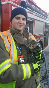"""Probationary firefighter Brandon Boettcher, of the Caledonia Fire Department, made his first """"save"""" today after he rescued a kitten from a sewer."""
