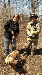 Daisy's owner Heimann (left) was happy to get Daisy. Firefighter Andy Pritzl helped rescue Daisy along with Jared Klug who is not in the photograph.