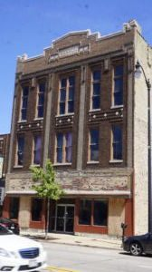Nicholson Buys Third Main Street Building