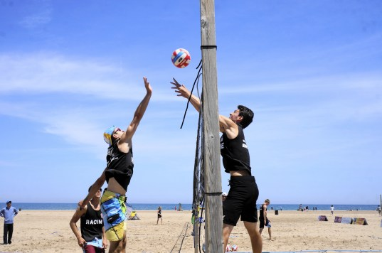 Eric Pupek blocks the volleyball after Matthew McCarthy puts the ball over the net. (Photo by Denise Lockwood)
