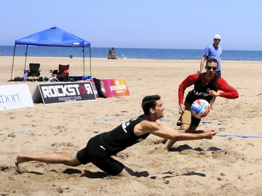 Matthew McCarthy dives to get underneath the volleyball at the EVP Tour in Racine on Saturday.