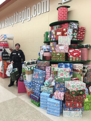 Officer Brian stopped by Santa in a Shoebox Tuesday to pick up some gifts for some of the kids who live in the neighborhood around the 16th Street COP house. Photo credit: Heather Asiyanbi