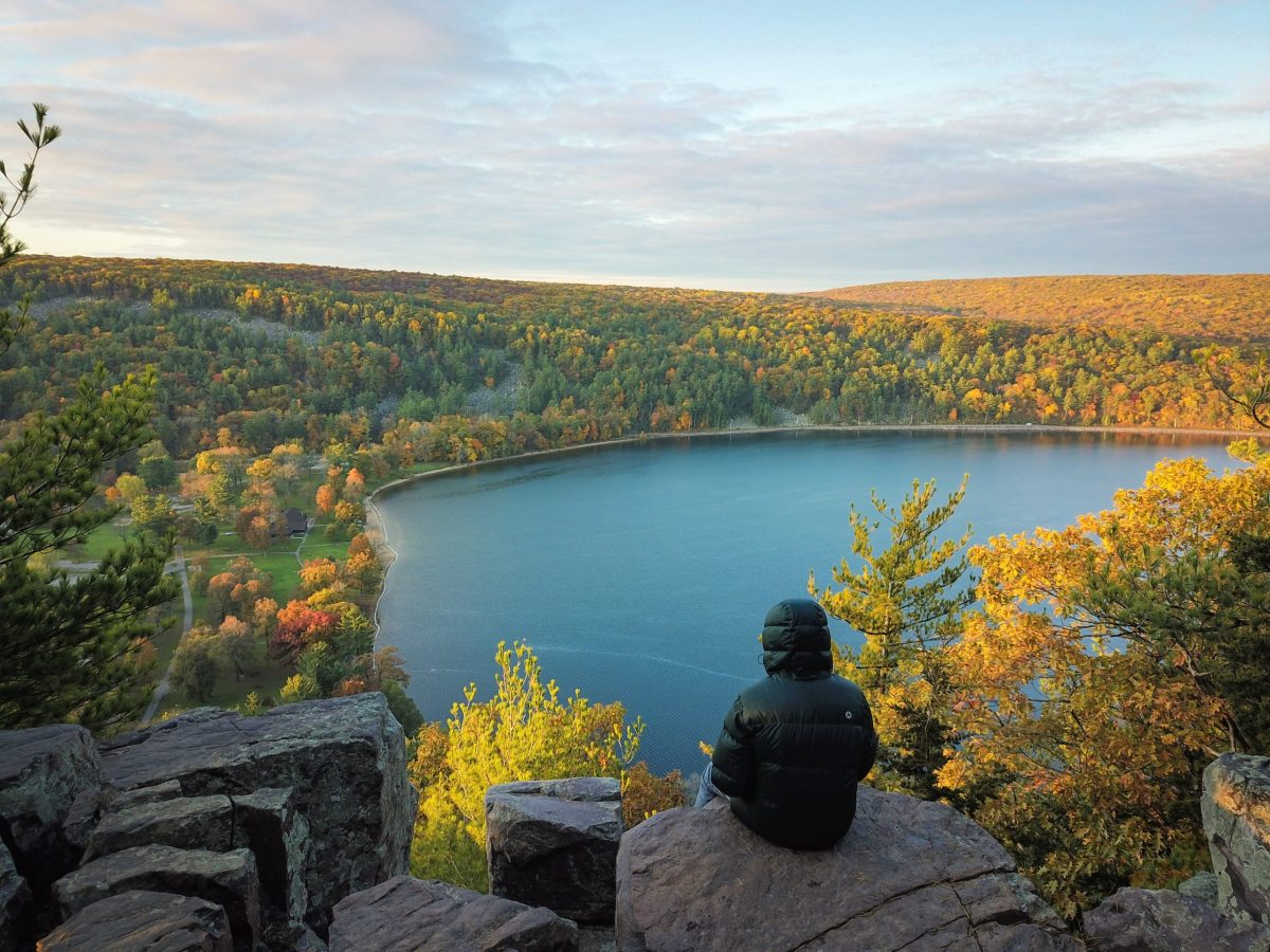 Hiker sitting at Devil's Lake State Park in Wisconsin