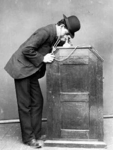 Man at Kinetophone, 1895.