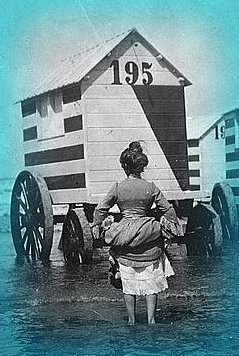 She wades to the bathing machine.