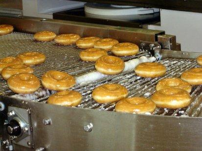 Krispy kremes being made, DO'Neil.