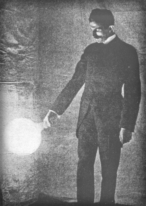 Nikola Tesla With Vacuum Bulb Image TeslaUniverse