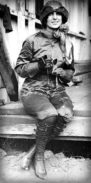 Harriet Quimby black and white photo sits on wing of airplane.