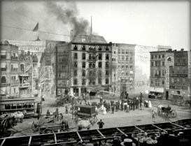 black and white photo of 6-story building on fire with audience atFlames Show. Image: Library of Congress.