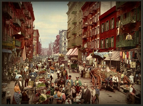 Crowded New York city Street in 1900 with Vendors and tall buildings.