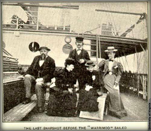 Mark Twain and three women plus one man on board deck of ship.