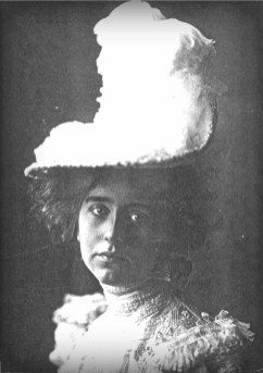 Black and white photo of Victorian lady in hat with large white feathers