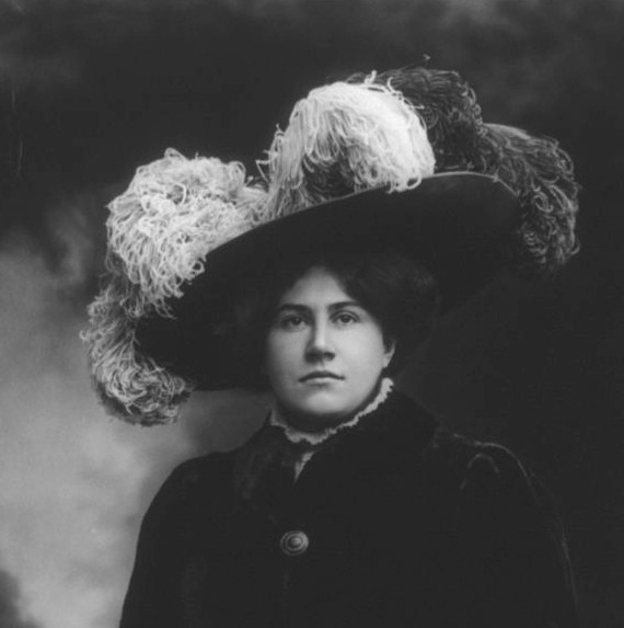 Victorian woman wearing hat covered in bird plumes