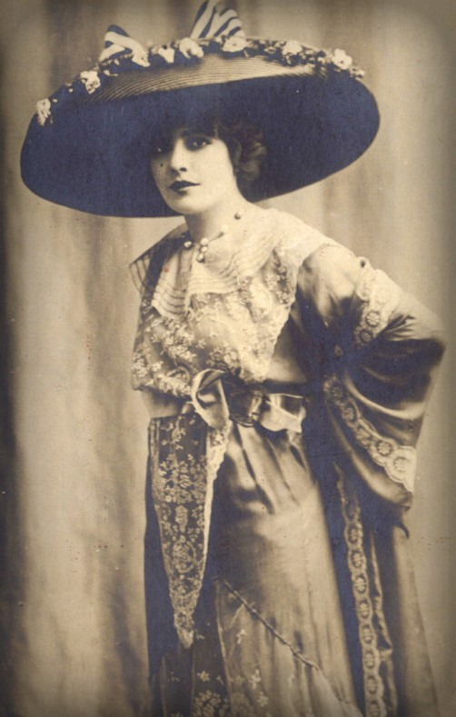 Edwardian woman wearing large brimmed hat with long dress