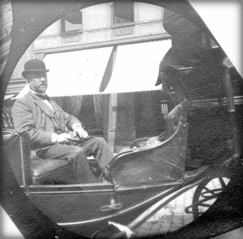 Victorian Era Spy Camera: Carl Stormer black and white photo of one man on a 2-person carriage. Image: wiki-visually.