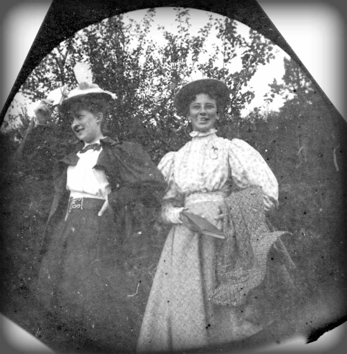 Victorian Era Spy Camera: black and white photo of two women in 1890 long skirts. Image: wiki-visually.