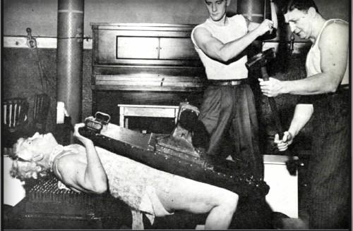 Sandwina Resists Blows To A Metal Door. Image: Article Iron Game History.