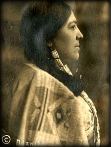 Waist up, side view photograph of Mary Baldwin Bottineau, 1914 in braids and Native American robe. Image: Library of Congress.