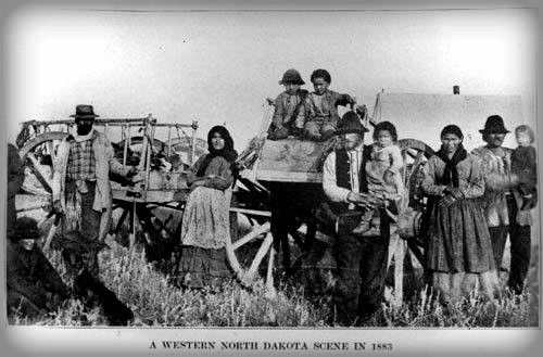 Photograph of mixed race Indian-European Family Family with Red River Carts in North Dakota, 1883. Image: Wikipedia.
