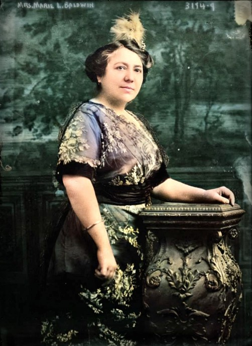 Mary Baldwin Bottineau photograph, side view, wearing silk dress and feathered hair ornament, 1914. Image: Library of Congress.
