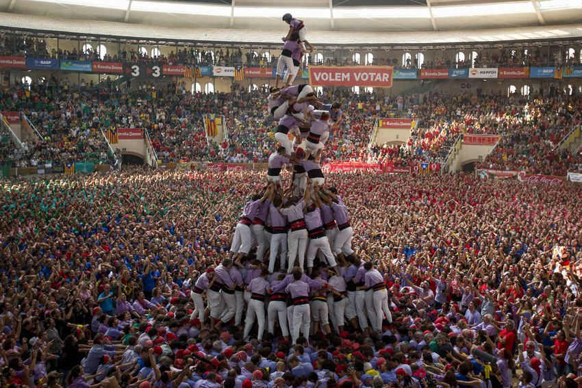 Tower of people standing on each others shoulders