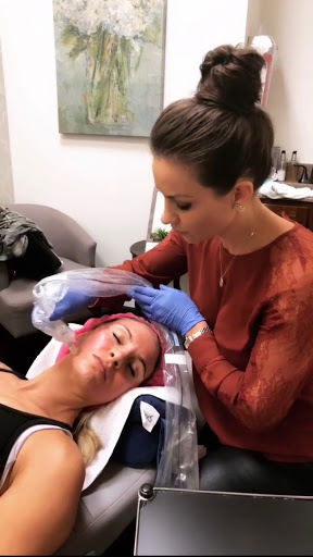 imaging showing a nurse, me, performing microneedling on a client who looks relaxed