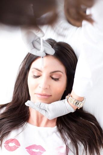 Racquel Frisella administering botox