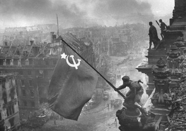 Rising a flag over the Reichstag