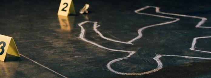 imagem ilustrativa de cena de crime marcação de corpo no asfalto