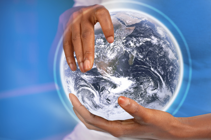 image of hands holding planet Earth