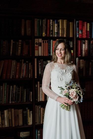 Smiling bride in Askham Hall Library