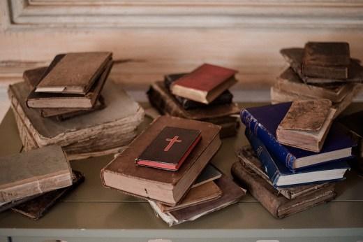 Old, hardback books in stacks at Askham Hall
