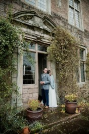 Bride and Groom in doorway of Askham Hall, Cumbria