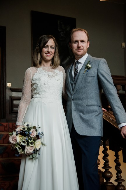 Bride and Groom on grand staircase at Askham Hall, Cumbria