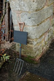 Pitch fork with sign waiting to be completed at Askham Hall
