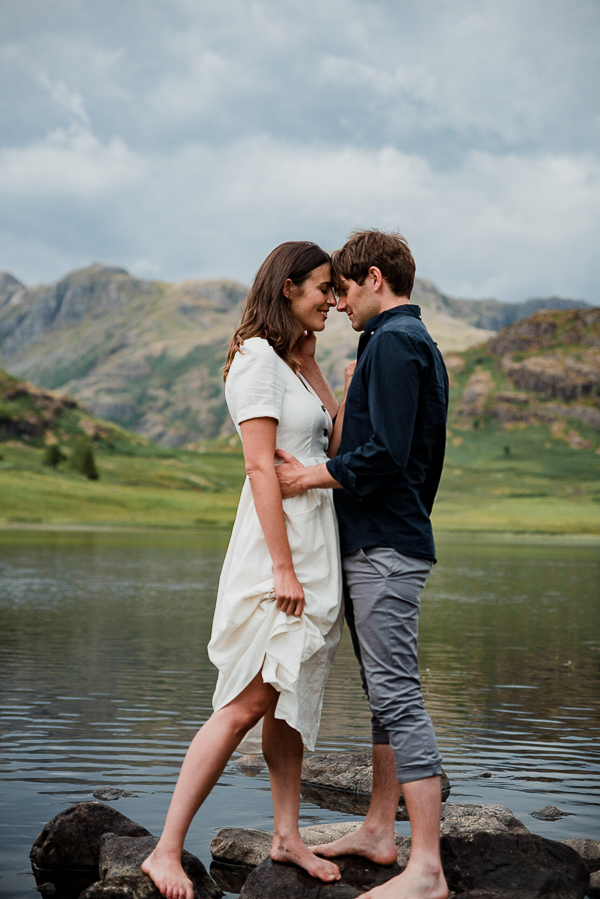 Couple in love at Blea Tarn by lake district wedding photographer
