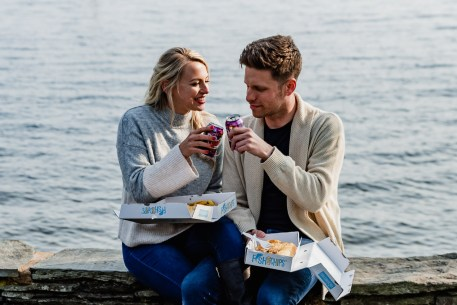 Celebrating their engagment with pop and fish and chips