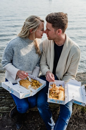 Posed nose to nose as part of their engagment photoshoot on the shores of Lake Windermere, Ambleside