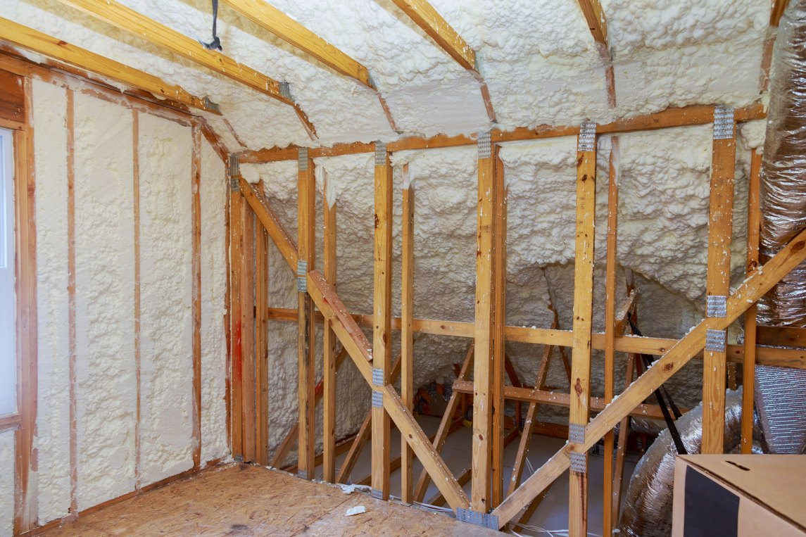 spray foam insulation in a newly constructed attic