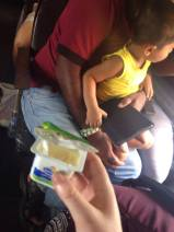 Sharing food with the loveliest little family on a train from Galle to Colombo.