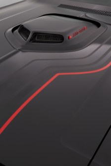 "The Shaker hood scoop is accented on top with a black ""Shakedown"" badge outlined in red, tying in neatly with custom gloss-black and gloss-red stripes."