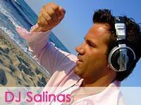 DJ Salinas - photo of Salinas on Ibiza beach with headphones on his head