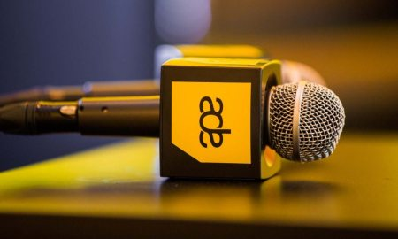Microphones with Amsterdam Dance Event logo on a table