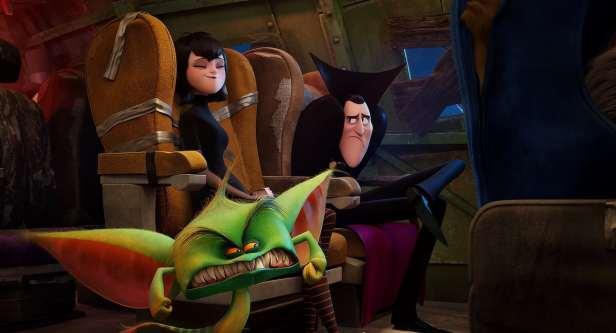 Mavis (Selena Gomez) and Dracula (Adam Sandler) with the airline crew on Gremlin Air in Sony Pictures Animation's HOTEL TRANSYLVANIA 3: SUMMER VACATION.