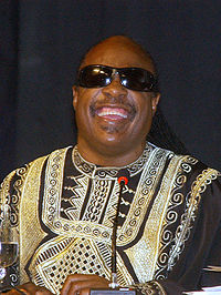 width=200 height=266 data-recalc-dims=1></noscript></a>According to a report by <strong>TMZ</strong>, A man claiming to be Stevie Wonder's nephew has been charged with attempting to extort the singer by threatening to go to the tabloids and say he's the product of an incestuous <strong>relationship</strong> between Stevie and Stevie's sister unless Stevie was willing to pay him a large sum of money.</p><p>Alpha Lorenzo Walker was arrested May 2 after being trapped in a <strong>sting</strong> operation. Law enforcement sources told <strong>TMZ</strong>, Walker initially demanded $<strong>5 million</strong> from Stevie but was shut down and eventually lowered his demand to $10,000.</p><div class='code-block code-block-2 ai-viewport-1' style='margin: 8px auto; text-align: center; display: block; clear: both;'> <script async src=https://pagead2.googlesyndication.com/pagead/js/adsbygoogle.js></script>  <ins class=adsbygoogle style=display:block data-ad-client=ca-pub-1174801101570566 data-ad-slot=8396837725 data-ad-format=auto data-full-width-responsive=true></ins> <script>(adsbygoogle=window.adsbygoogle||[]).push({});</script></div><p>Those same sources said undercover cops met Walker, claiming to be Stevie's reps who had the cash, but demanded that he first sign a document which included a statement that his accusations were false. Walker signed, and he was promptly arrested.  According to those sources there was absolutely no evidence that the <strong>allegations</strong> were true and it seemed to be a completely bogus attempt at getting some money.</p><p>Walker has been charged with felony extortion, along with his girlfriend. He has pled not guilty. Walker is currently in custody.</p></div></div><div class=